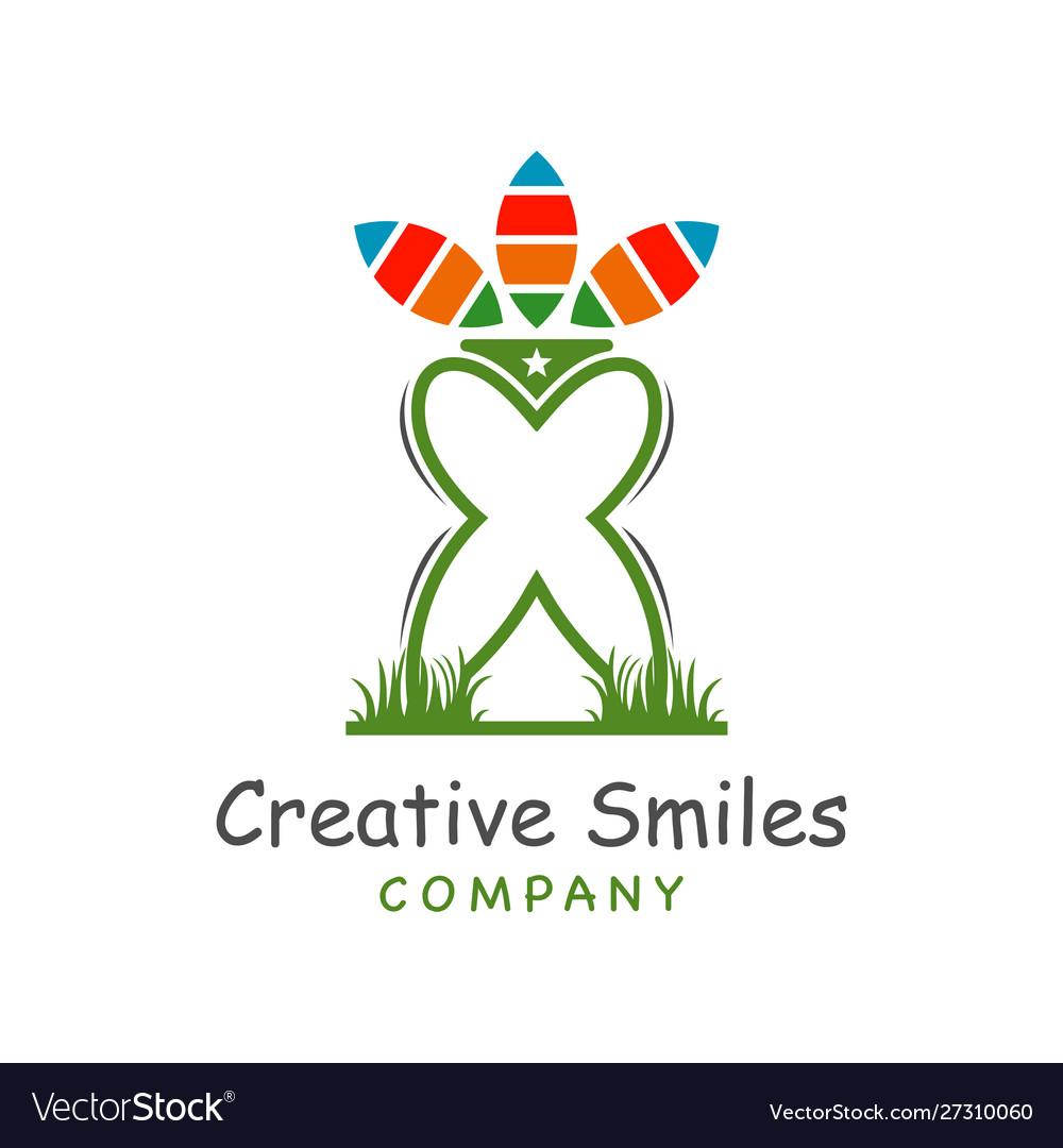 Tooth logo design on grass
