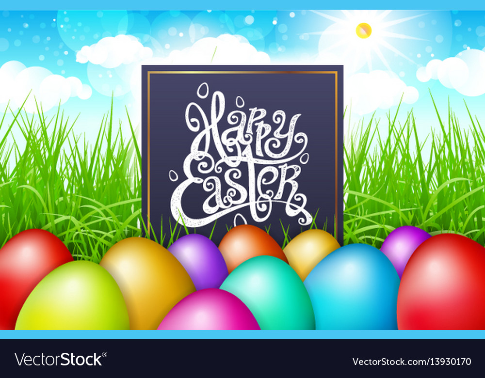 Colorful eggs in a field of grass with blue sky
