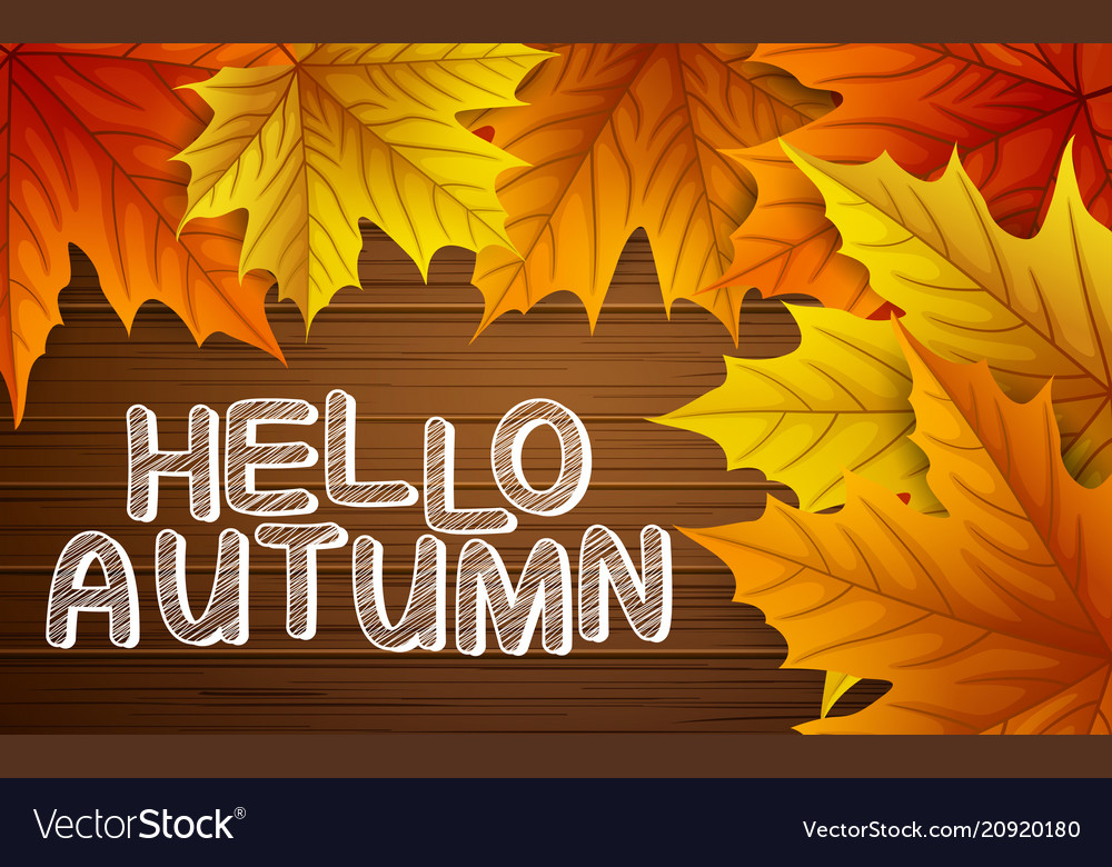 Autumn leaves with lettering on wooden background