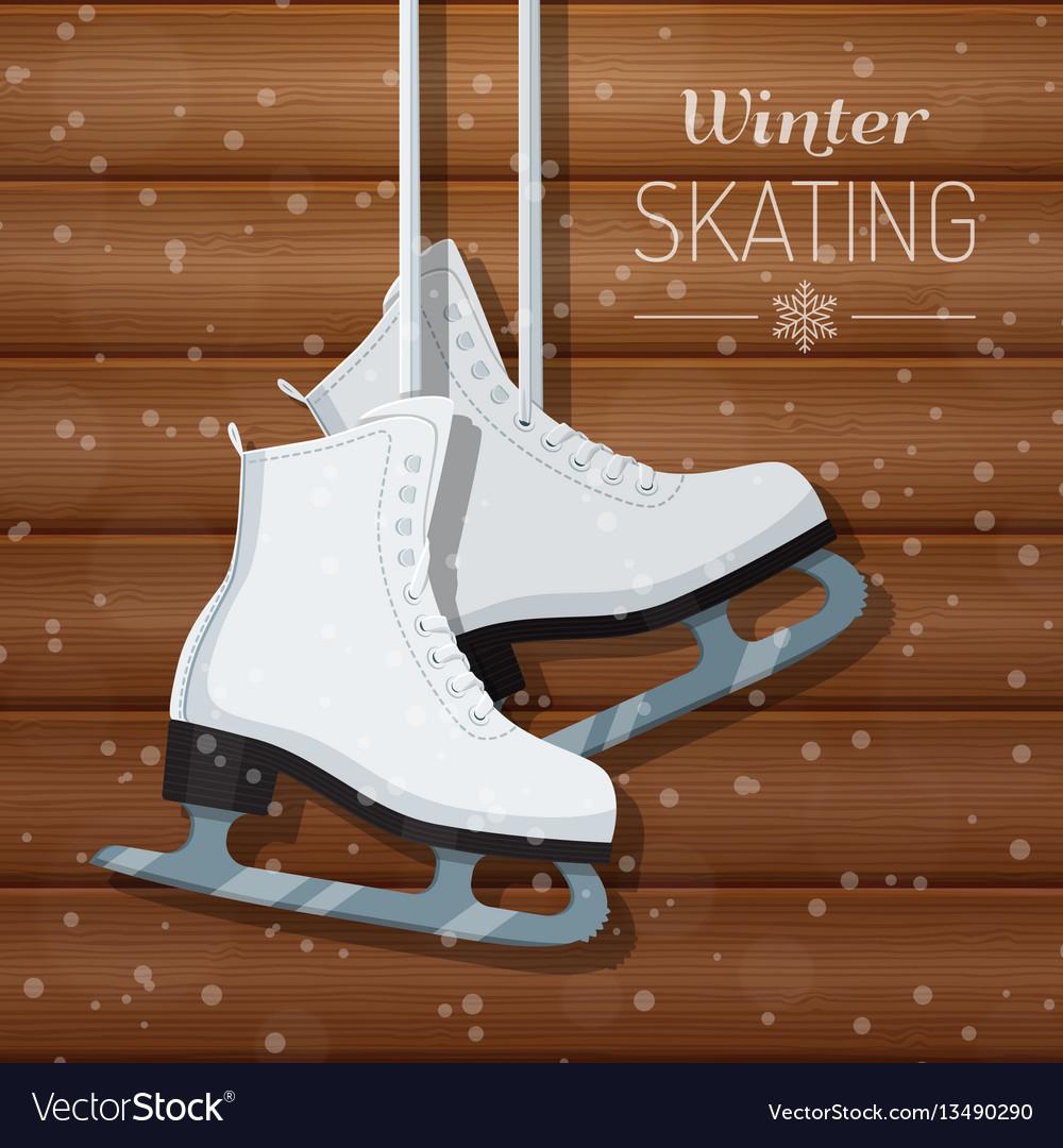 White ice skates on wooden
