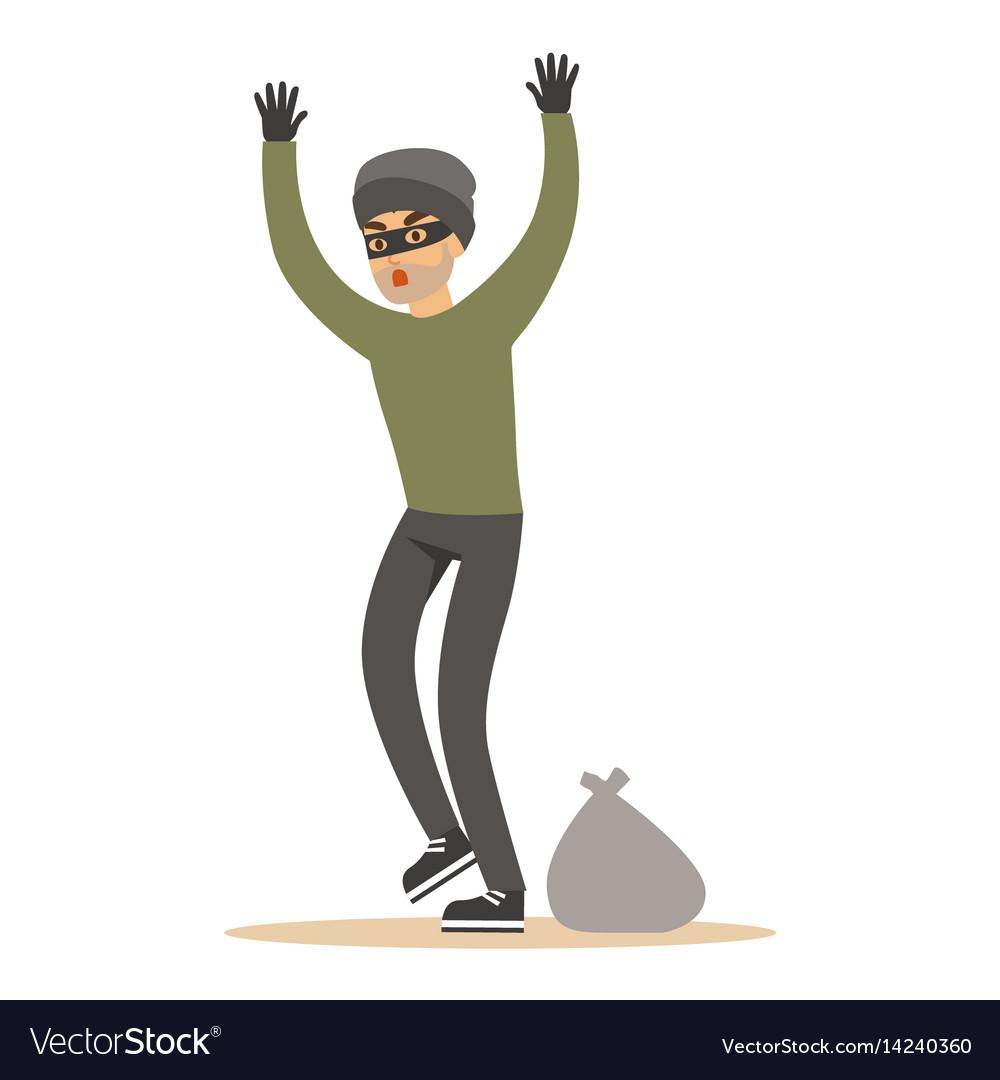 Robber man in black mask holding hands up