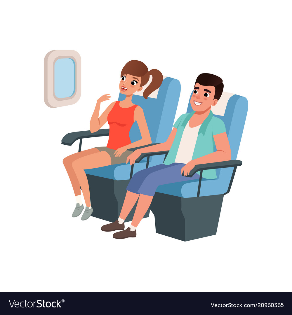 Young tourist couple sitting in airplane seats
