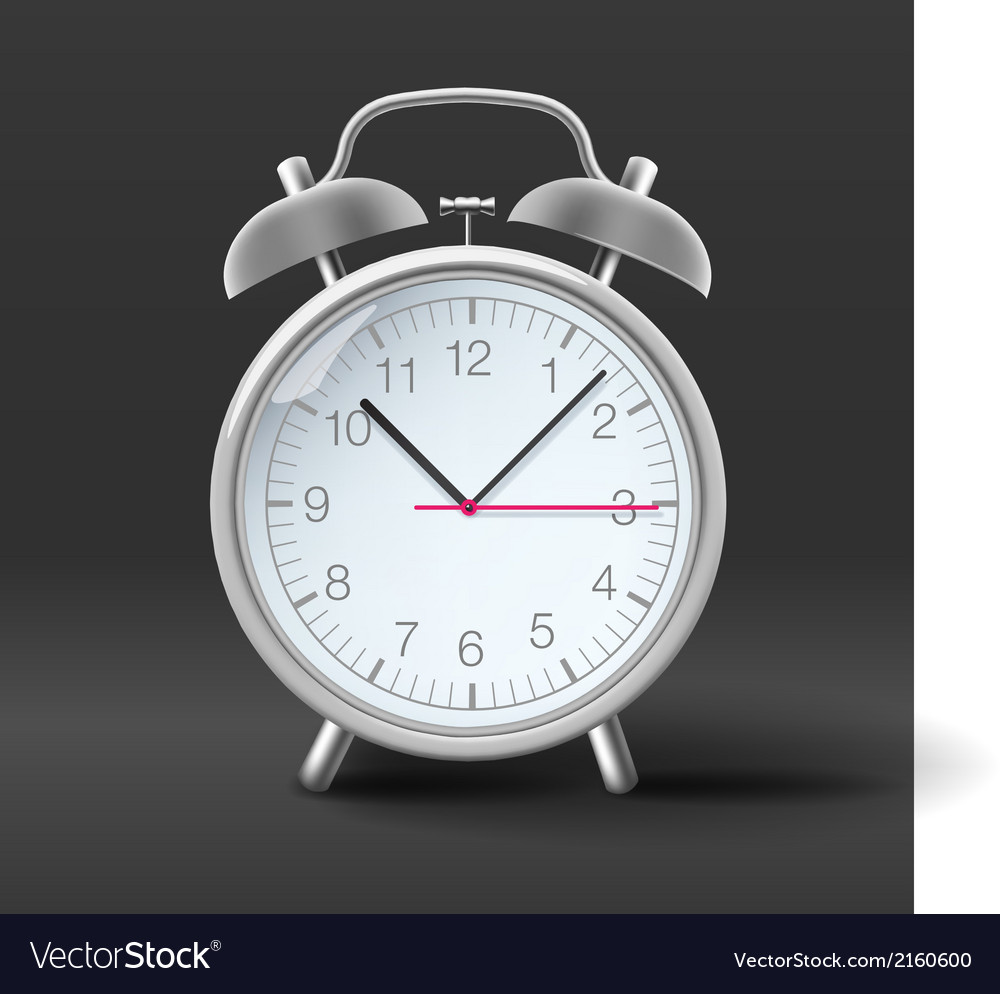 Vintage alarm clock on grey background