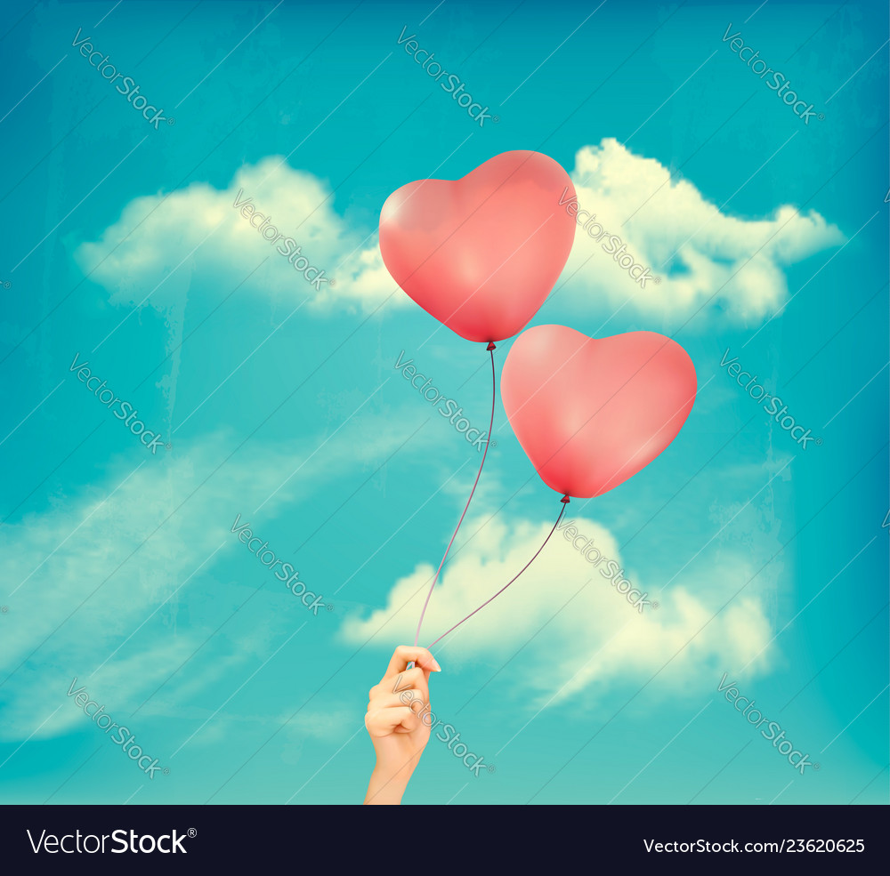 Valentine heart-shaped balloons in a blue sky