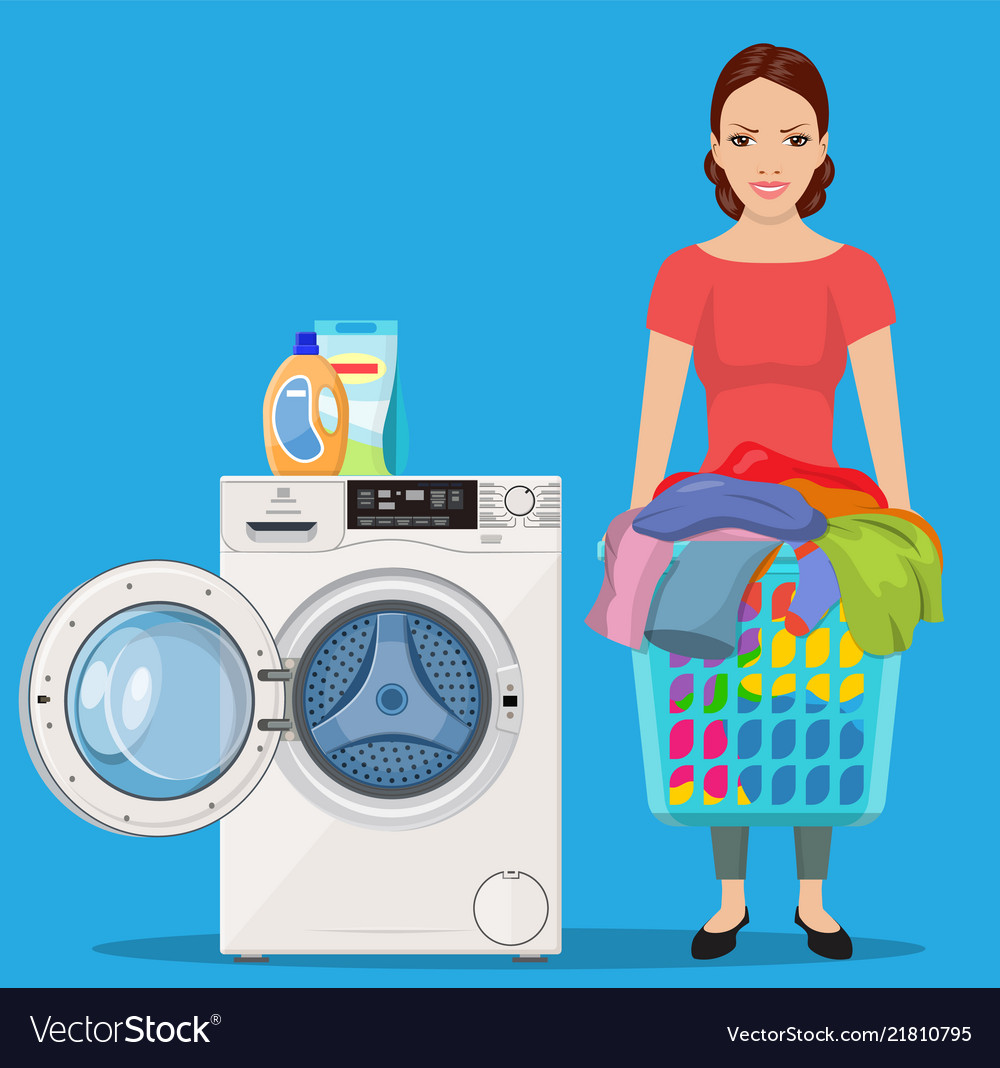 Cheerful girl standing and holding laundry basket