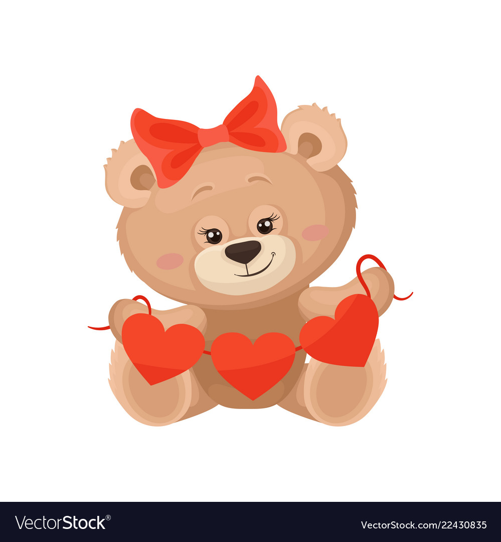 Girly teddy bear with red bow on head holding