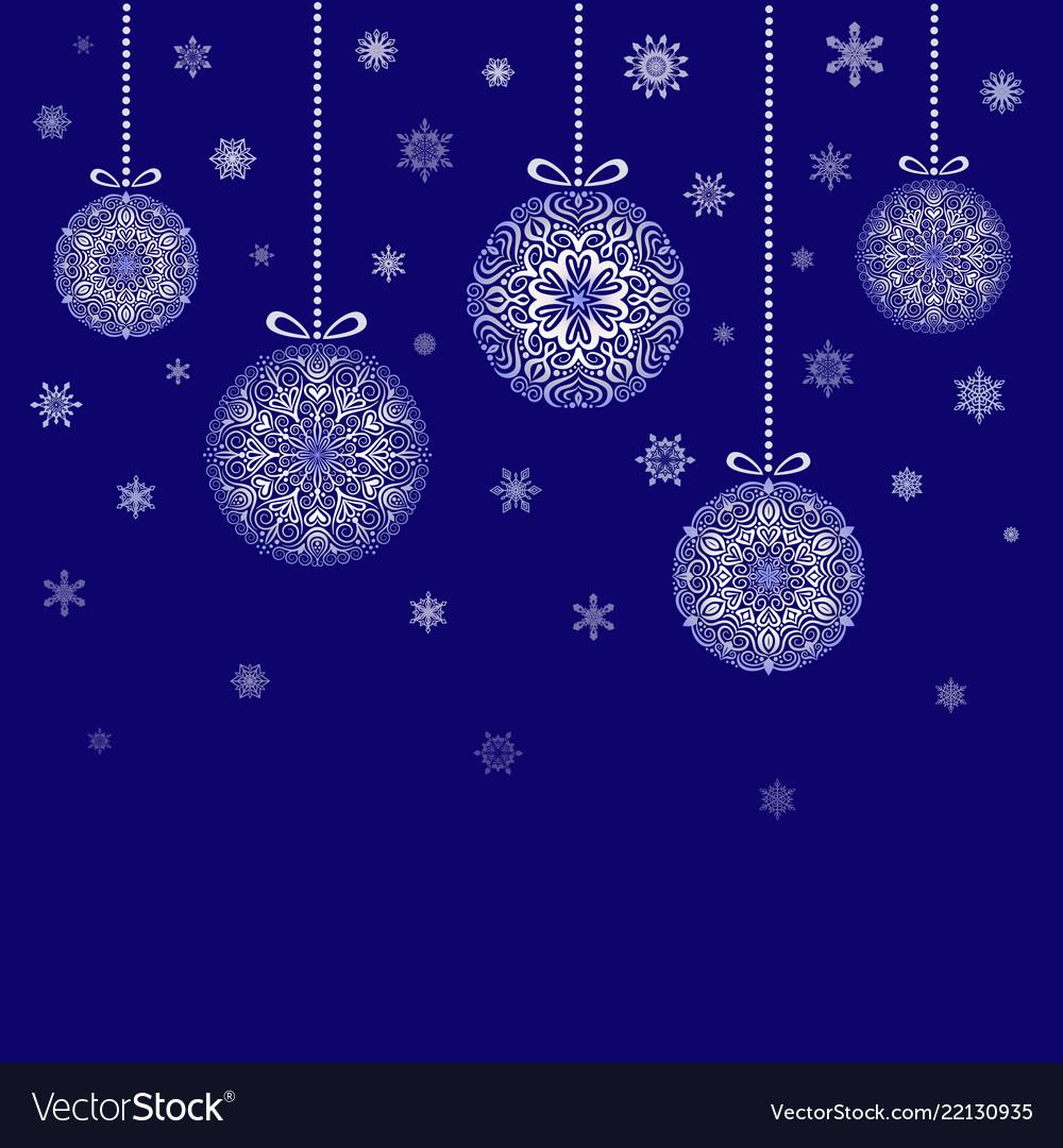 Christmas balls hanging on blue background