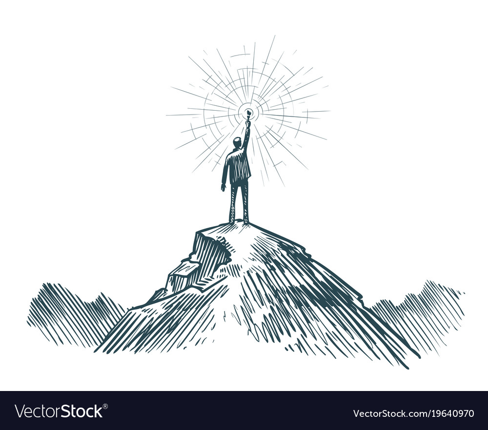 Man stands on top of mountain with torch in hand