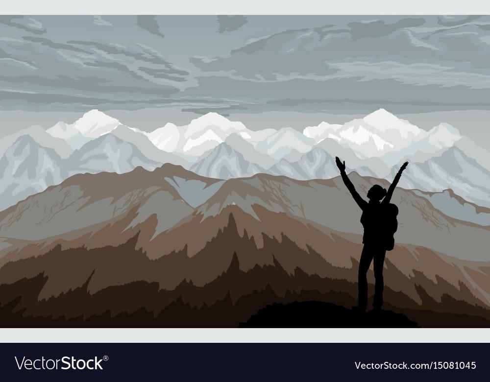 Hiker enjoying landscape with mountains