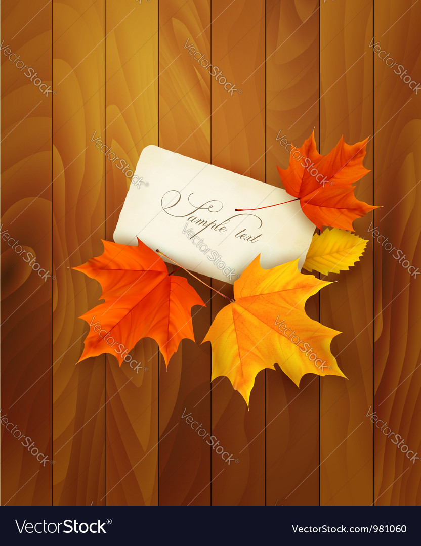 Card with leaves on wooden background