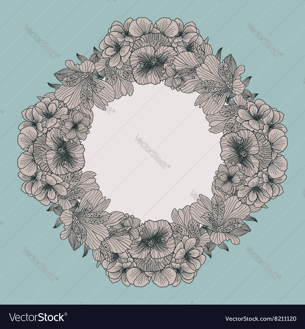 Frame made of vintage flowers on teal background