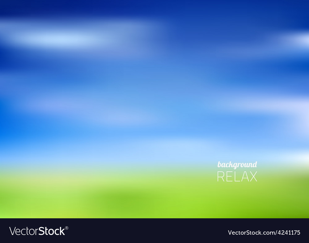 Blurry green field and blue sky
