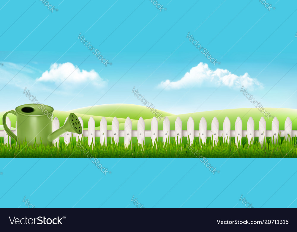 Watering can on spring garden background with