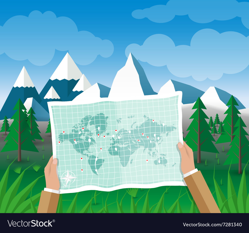 Man on a hiking trip holding map in his hands