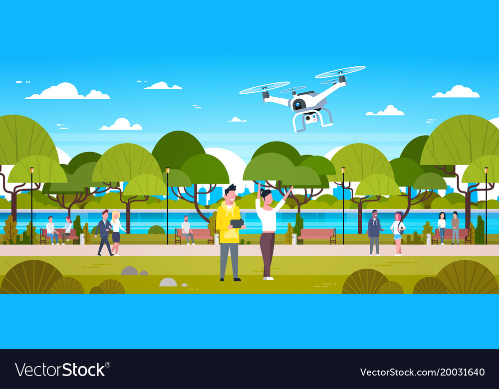 Couple flying drone in park man and woman using