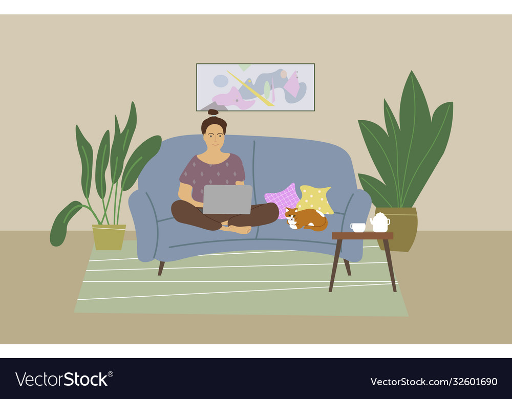 Cute young woman sitting on couch with laptop