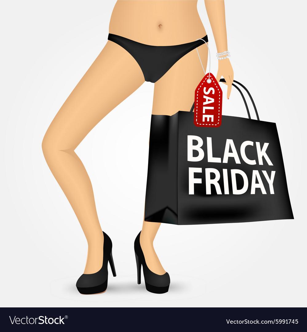 Woman legs on high heels holding shopping bag