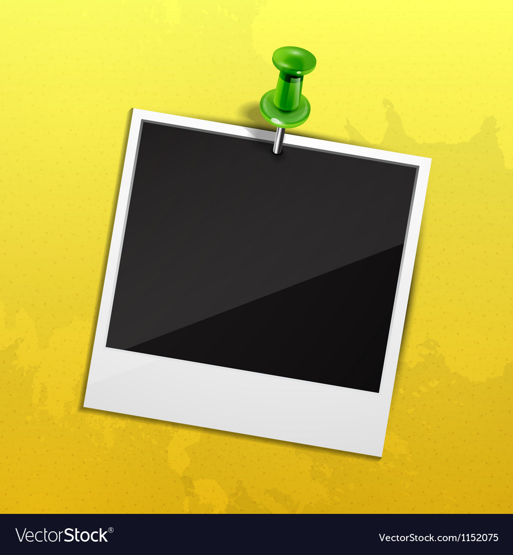 Photo on yellow wall fixed with green pin