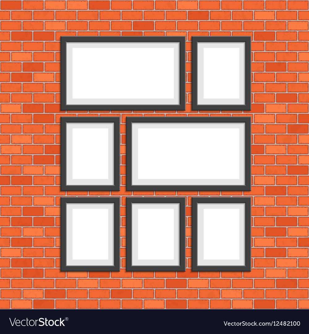 Picture photo frames on red bricks wall