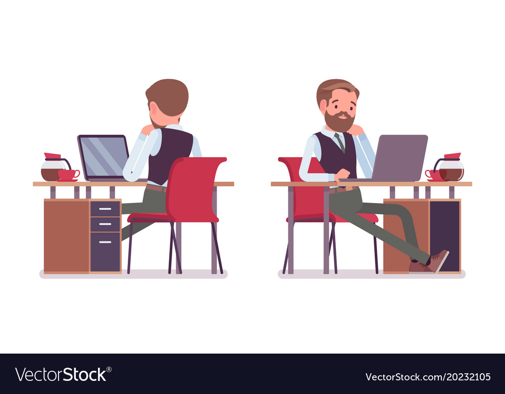 Handsome male office employee sitting at desk