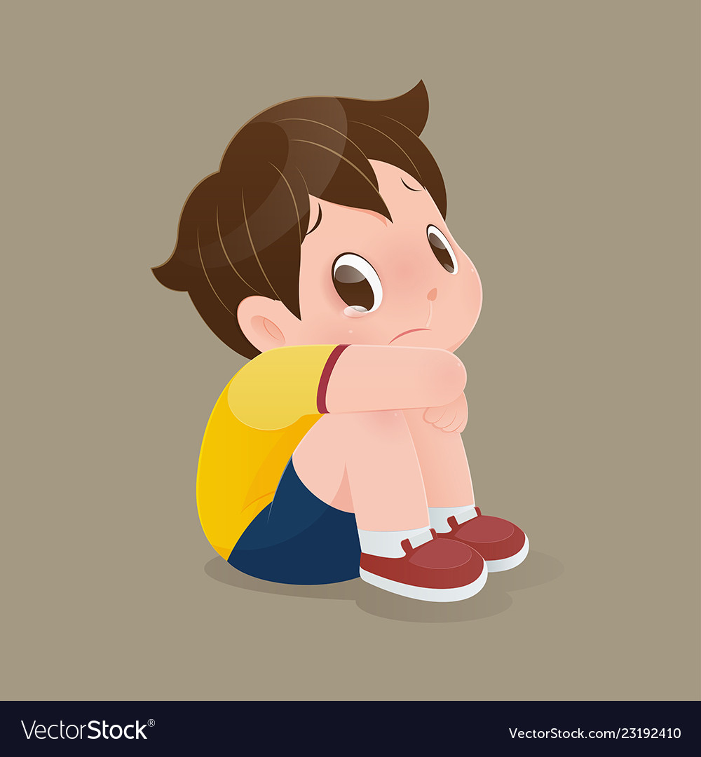 Boy sitting crying