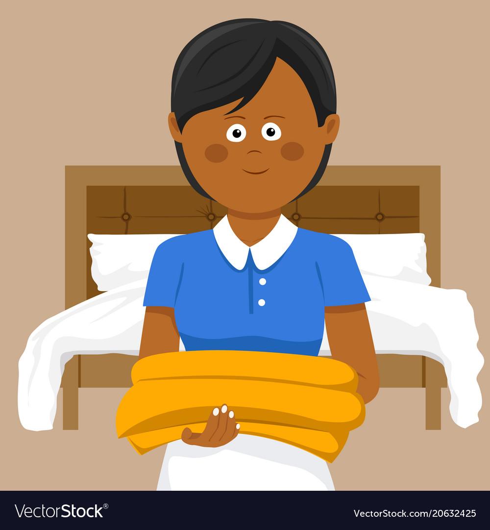 Female housekeeper carrying towels in hotel