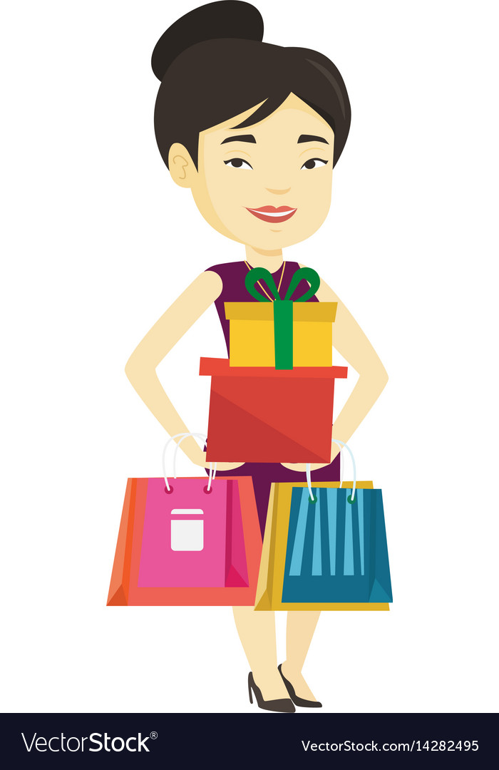 Happy woman holding shopping bags and gift boxes