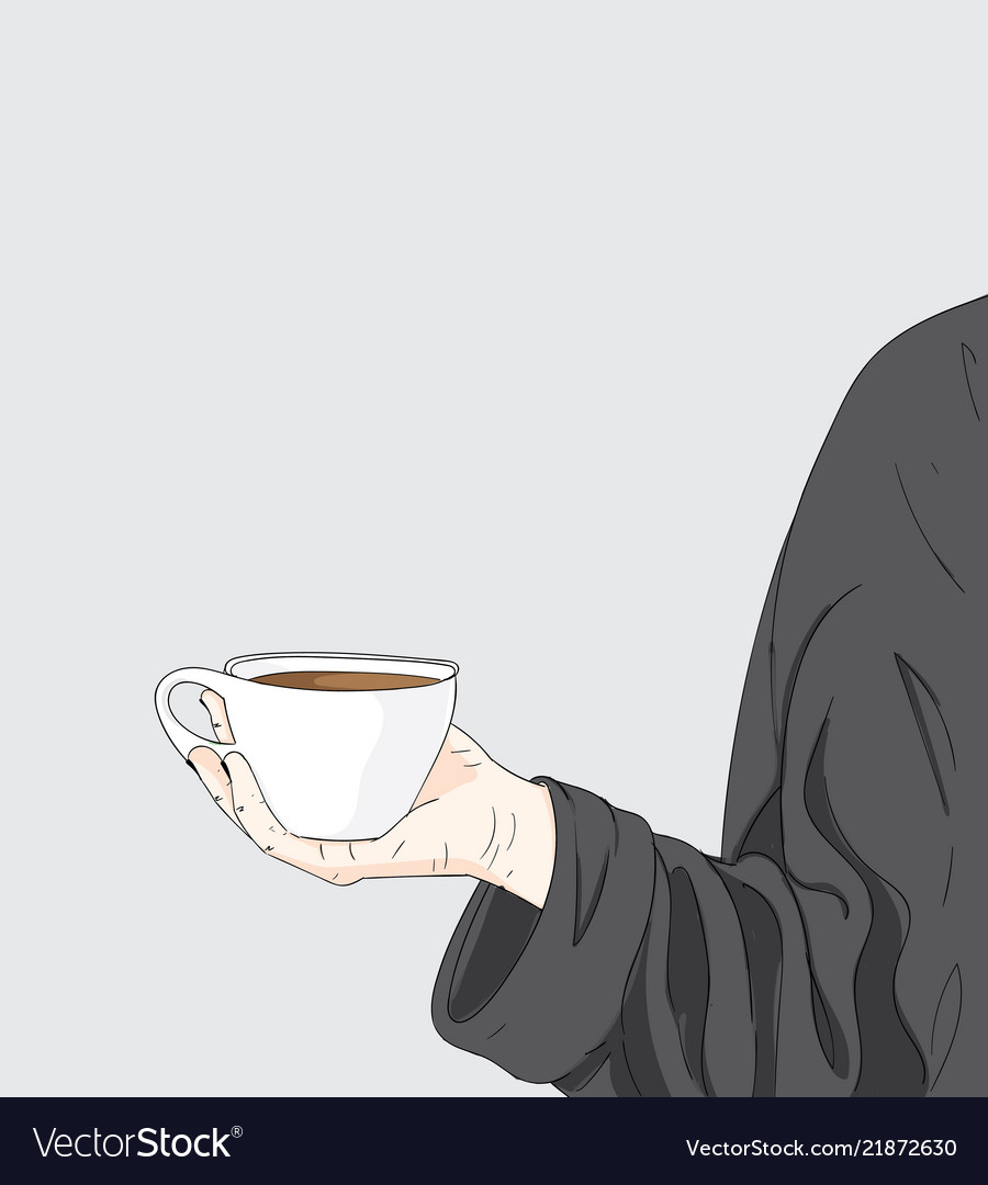 A woman is holding a cup of coffee
