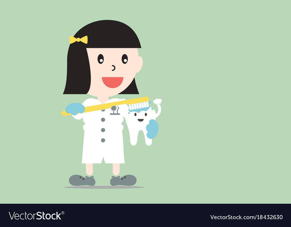 Female dentist demonstrates brushing teeth model