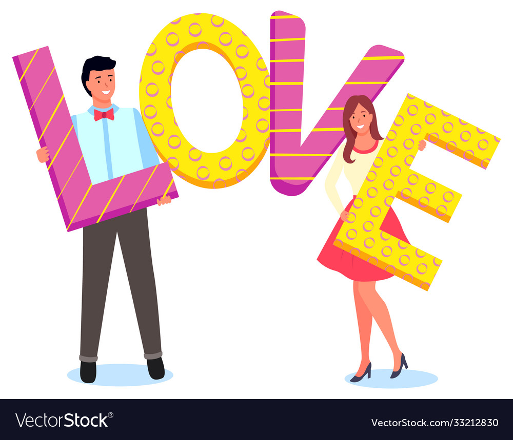 Cute couple holding letters word love