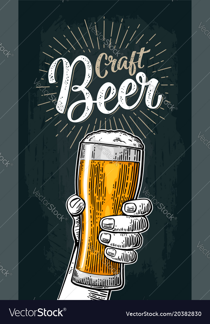 Male hand holding a glass craft beer lettering