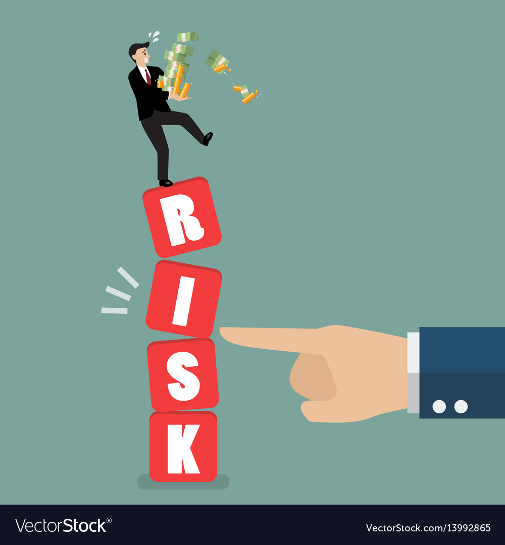 Businessman standing on shaky risk blocks by hand