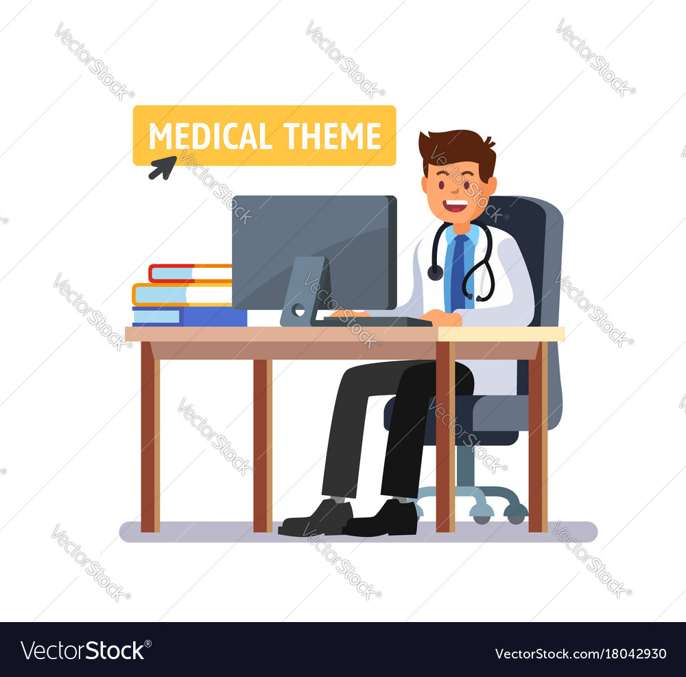 Doctor sitting at the table working on computer