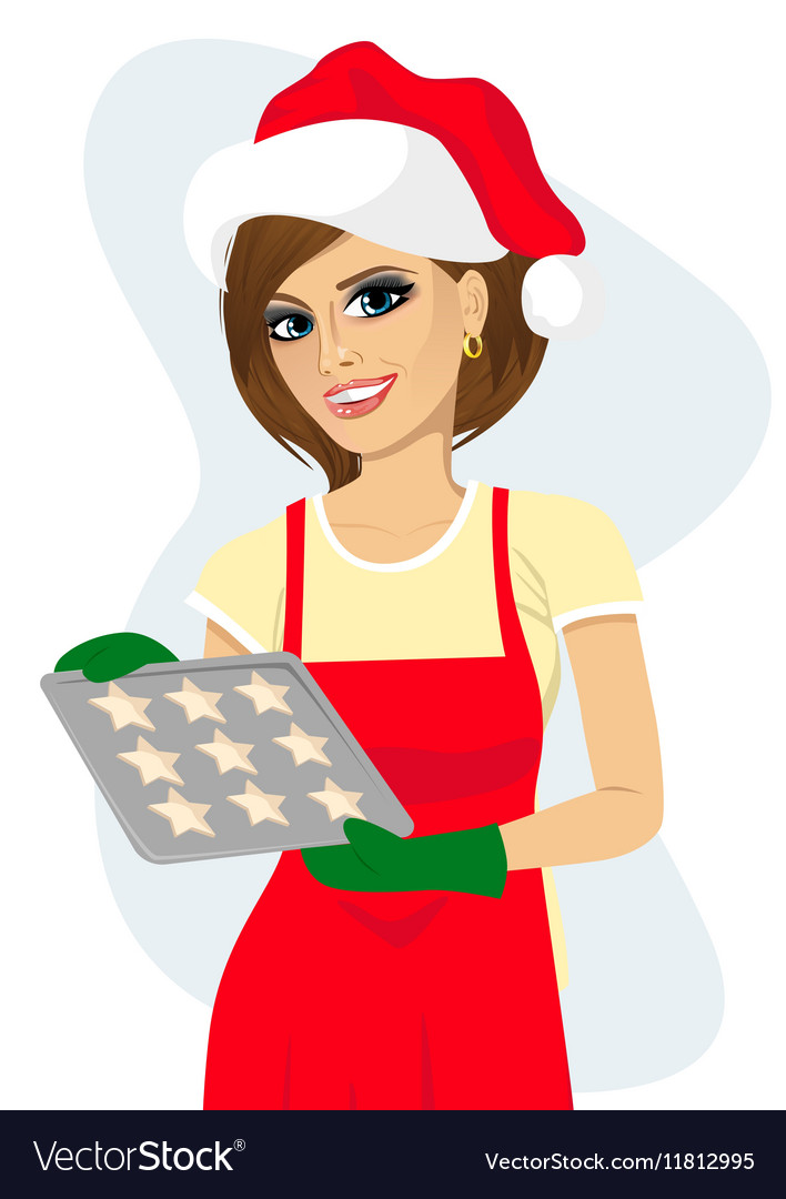 Woman holding tray with baking cookies