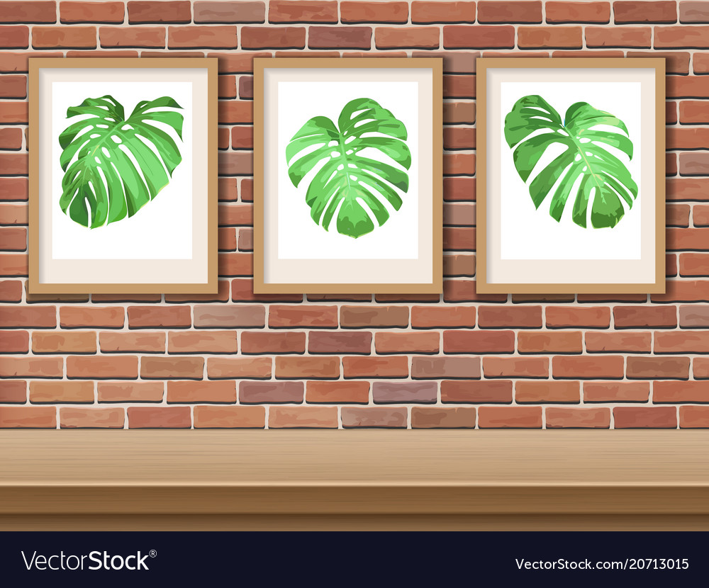 Picture with monstera on a brick wall