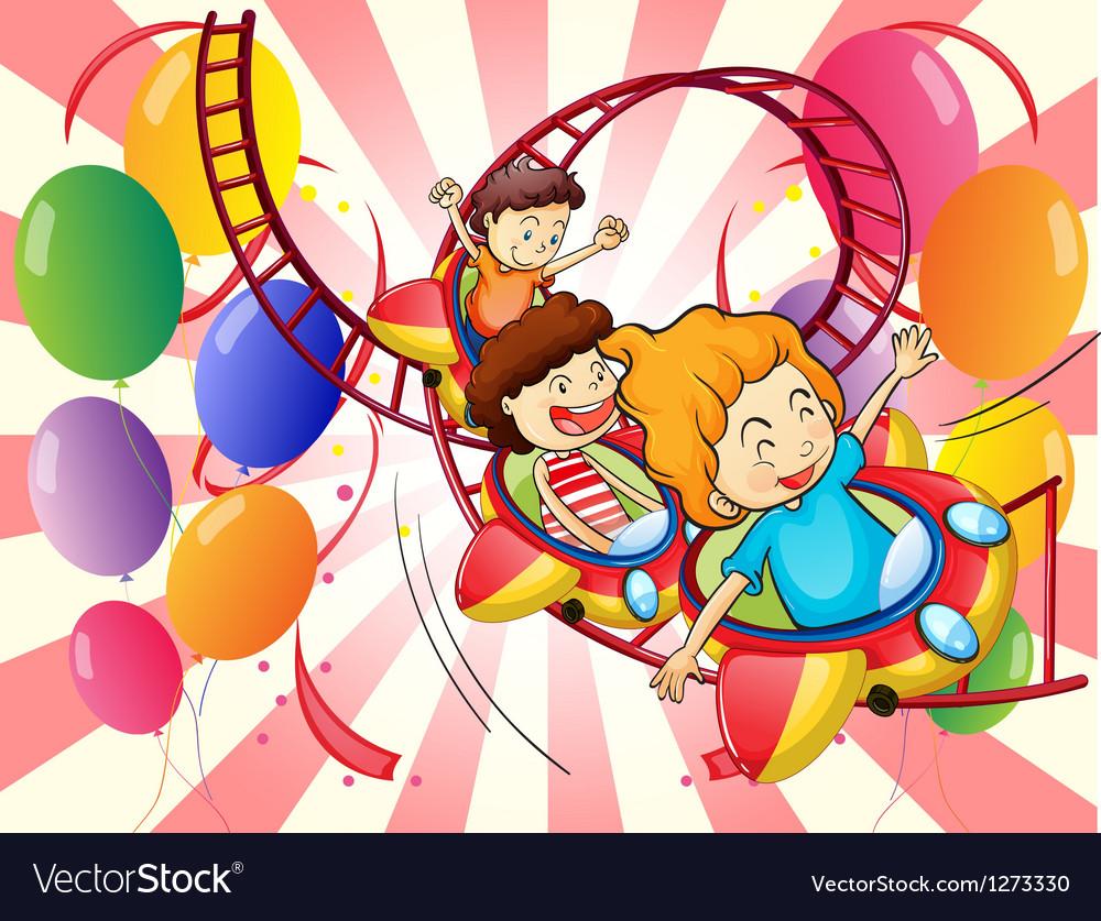 Kids enjoying the roller coaster ride vector image