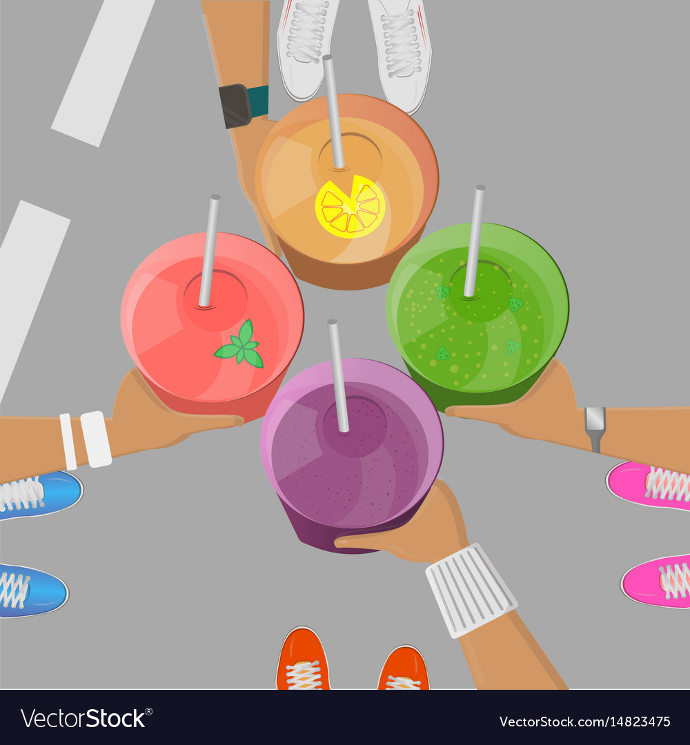 Sport girls holging smoothies in hands top view