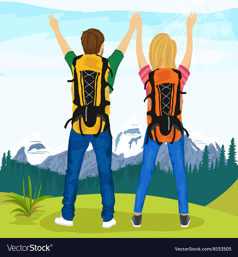 Young couple of hikers standing on top of mountain