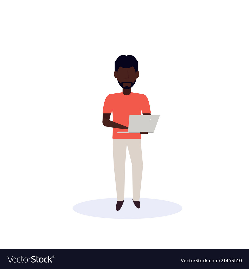 African american man using laptop standing pose