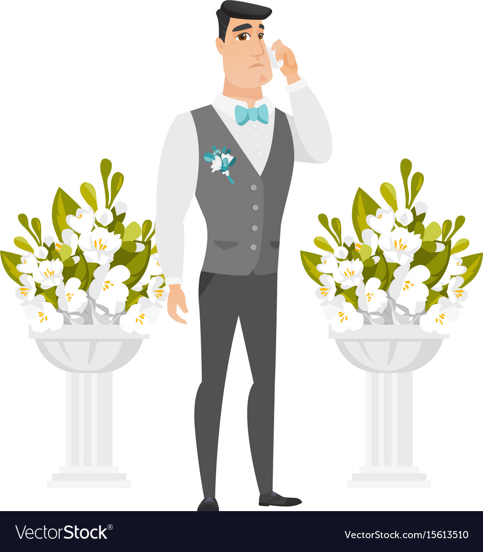 Caucasian groom crying during wedding ceremony
