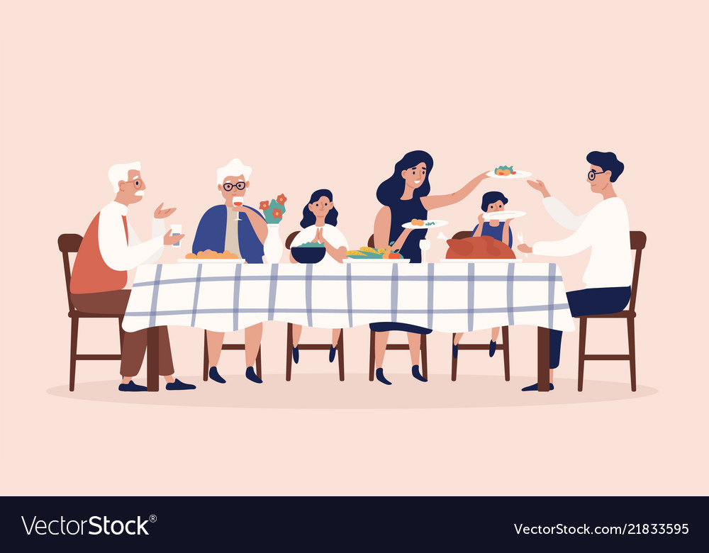 Happy people sitting at table eating holiday