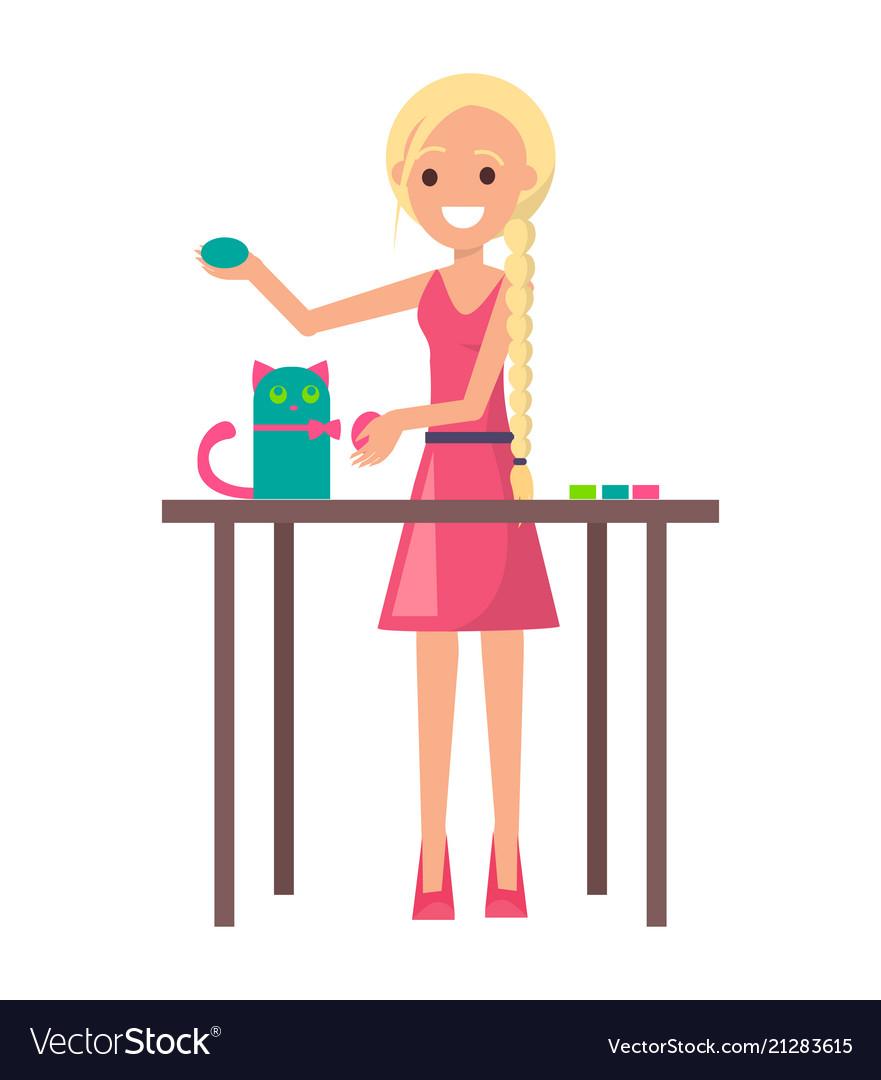 Joyful blonde girl with cute handicraft kitten