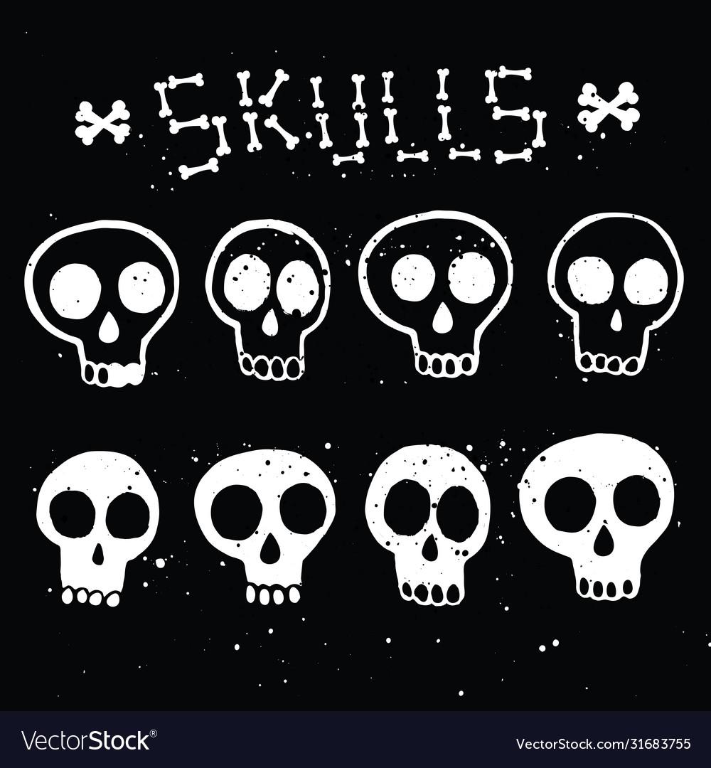 Set white skulls in ink on black