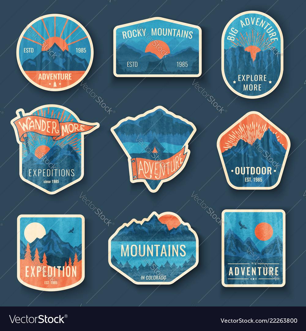 Set of nine mountain travel emblems with grunge