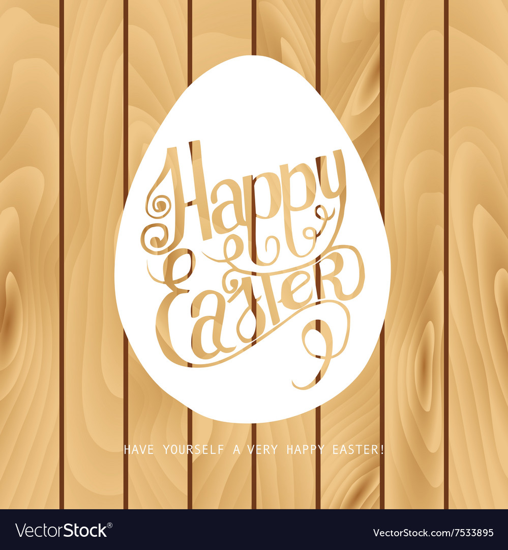 Inscription happy Easter on the wooden background
