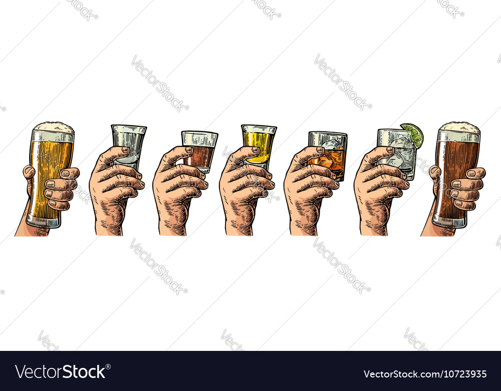 Male hand holding a glass with beer tequila