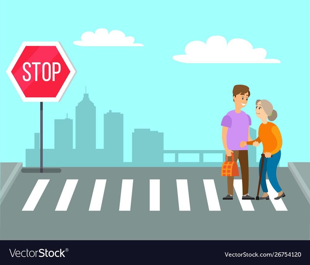 Volunteer helps granny to cross road on pedestrian