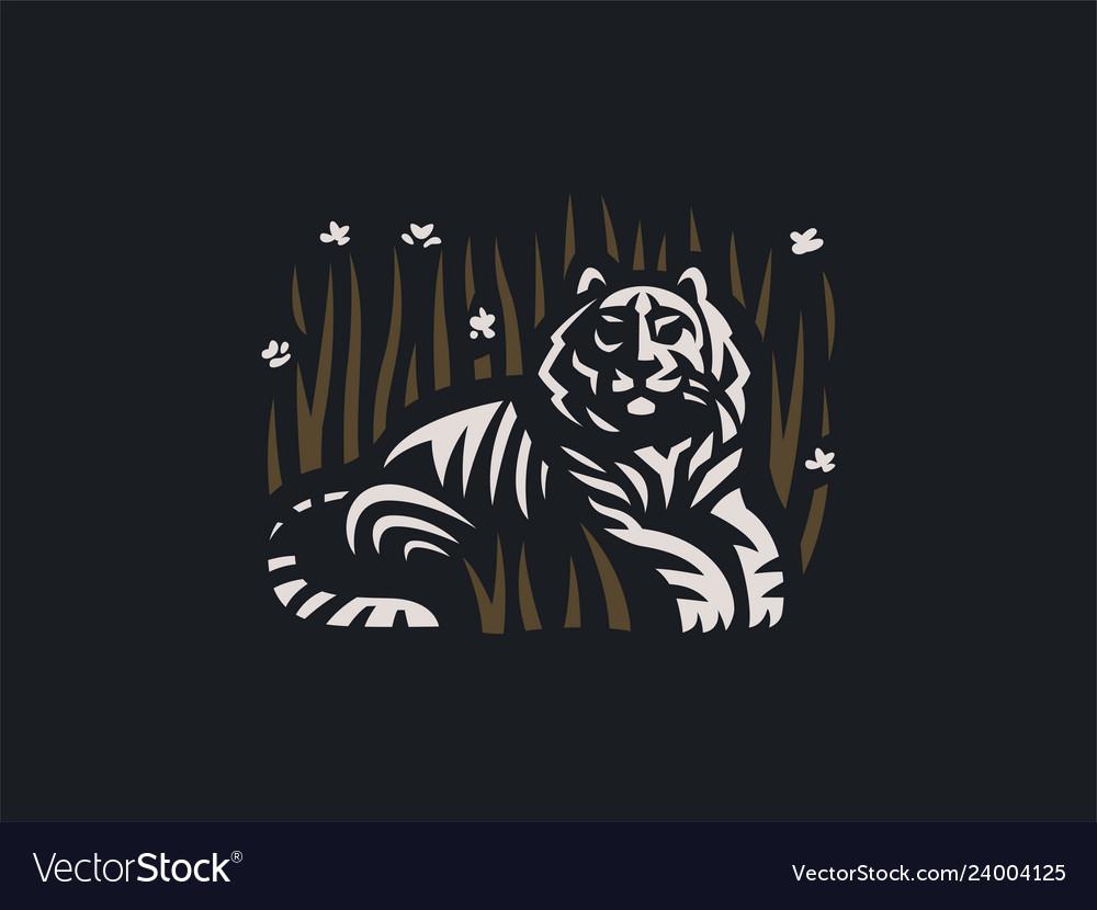 Tiger lies in grass