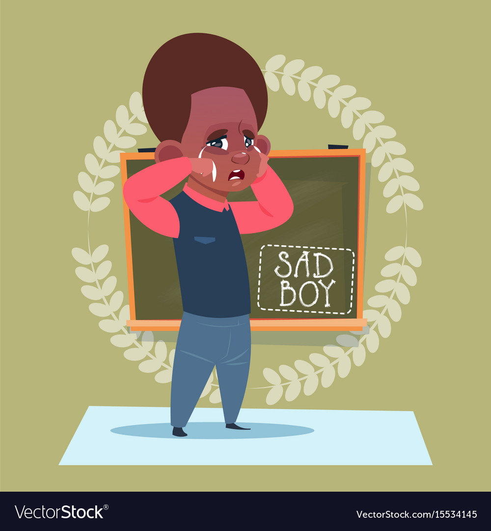 Small sad school boy standing over class board