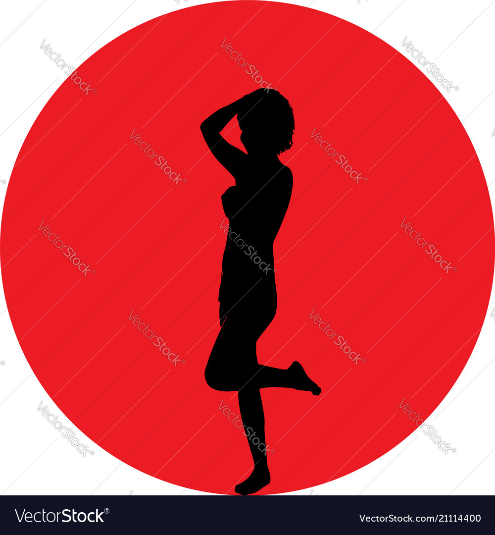 Silhouette of woman over red sun